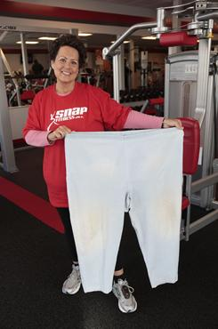 Sue Hentschel of Harrison Township, Mich., holds up the large slacks she wore before she lost 145 pounds.