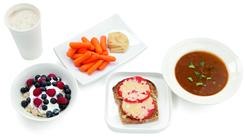 A healthy breakfast could include a 12-ounce non-fat latte;1 cup of oatmeal with cup non-fat plain yogurt and cup berries. For a snack of 157 calories try 1 cup baby carrots cup hummus.