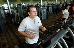 Tim Wooding has lost a lot of weight working out and eating well. He has learned to incorporate more exercise into his life; goes up and down the stairs at work; and eats five meals a day and works out every morning.