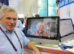 Vitallink shows Rich Brown, president of VitalLink, displaying the video chat capabilities of the VitalLink touch screen computer system.