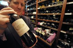 Photo shows a bottle of Chateau Margaux Bordeaux 1989 being displayed in Hong Kong. China and Hong Kong s unquenchable thirst for Bordeaux wine has made their combined market, worth 333 million euros (430 million US dollars), the number-one export client for Bordeaux in value terms.
