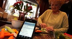 """My cooking has changed,"" says Marilyn Pearson, 67, of Rochester Hills, Mich. Here, she prepares a turkey lettuce wrap. She keeps track of her calories on her iPhone"