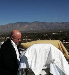 Mark Kelly with his wife as she looks from her bed at the Santa Catalina Mountains on Thursday at University Medical Center in Tucson. U.S. Rep. Gabrielle Giffords was transferred to Houston for rehab on Friday.