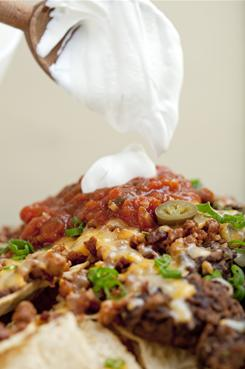 Nachos are a popular Super Bowl party snack that pack several calories.