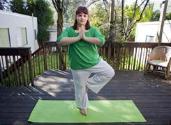 Emily Whalen likes doing Yoga on her backyard deck. Whalen lost 56 pounds on Weight Watchers.