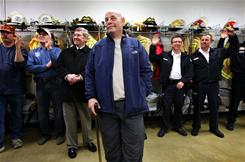 Heart attack survivor Howard Snitzer looks at the group gathered around him at the Goodhue Fire Department.