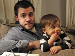 Chris Illuminati, 33, sits with his one-year-old son Evan. A writer and stay-at-home dad, Illuminati said he had depression symptoms starting when his son was about 4 months old.