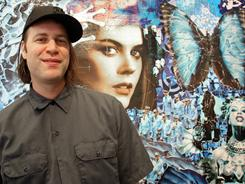 Established collage artist Michael Anderson with his work on display at the Claire Oliver Gallery in Manhattan, where he currently has a solo show.