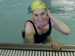 Jonnye Clark, 65, takes a break between swim laps at Cornerstone Health and Fitness in Warrington, Pa.