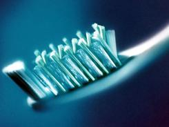 Using a toothbrush can help eliminate food residues and bacteria.