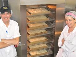 Jules Shepard teamed up with Lee Tobin of Whole Foods Market at its gluten-free bakehouse to bake 180 sheet cakes needed for a giant gluten-free cake.