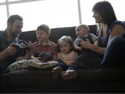 The Dunlevy Family: Mom Erin, father Luke, kids Clark, 4, Alice, 2, and Hal, 8 months, at their home.