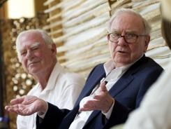 Philanthropists Gerry Lenfest, left, and Warren Buffett take part in a discussion Friday in Tucson.