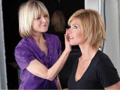 Makeup artist and book author Sandy Linter applies makeup to model Kim Alexis.