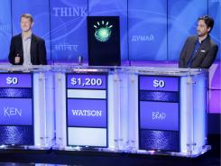 """Jeopardy!"" champions Ken Jennings, left, and Brad Rutter, right, look on as the IBM computer called ""Watson"" beats them to the buzzer Jan. 13."