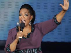 "Oprah Winfrey acknowledges fans during a star-studded double-taping of ""Surprise Oprah! A Farewell Spectacular, in Chicago."