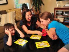 Ann Marie Ryan, 39, of Westfield, N.J., plays Zingo with her children, Liam, 6 and Emma , 8. Ryan has a cooler-full of suggestions for parents of school-aged kids.
