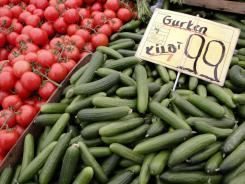 Tomatoes and cucumbers from Holland are displayed for sale at a market in Berlin, Germany on Friday.