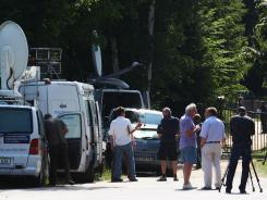 Media stand in front of shuttered Gaertnerhof Bienenbuettel organic farm Monday in Bienenbuettel, Germany.