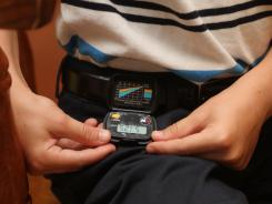 Making a game of it, Kyle Wolf, 9, checks his pedometer before heading to South Beach Park to walk with his family.