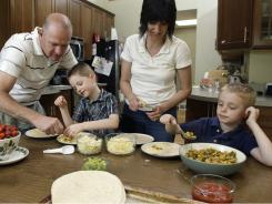 The Ammer family, from left to right, Bryan, Neil, Amanda and Reid prepare quesadillas made with fresh vegetables at their home.