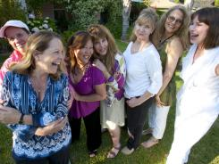 That's what friends are for: Emily Aiken, left, Shelley Herman, Roxanne Yamaguchi Moster, Dinah Brein-McClellan, Chris Gallagher, Sue Brownstein and Debbie Pettit met as NBC pages in the 1970s.