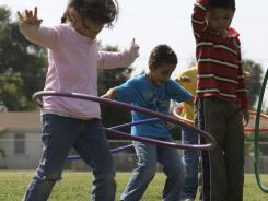 Children at Tracy Elementary School, part of the Baldwin Park Unified School District, spin hula-hoops, part of  after-school exercise activities.Over the past five years, six low-income communities, including Baldwin Park, were targeted for a broad spectrum of improvements to schools and neighborhoods.
