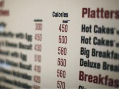 Calories of each food item appear on a McDonalds drive-thru menu in New York.