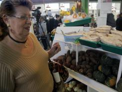 Jenny Rodriguez, 69, shops at La Marqueta, an East Harlem marketplace, after traveling by school bus in New York.