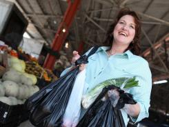 Donna Terry, who has cleared the hepatitis C virus using a new drug combo, shops at the Dallas Farmers Market.