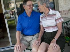 Roy O'Connor, 74, and his wife Lynn O'Connor, 69, pose for a portrait outside their apartment at Greenspring Village Retirement Community,