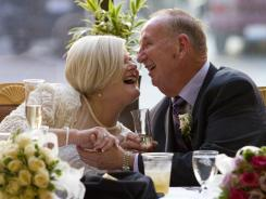 Lynn Eckert, 69, and her husband, Richard Stelter, 71, celebrate their wedding at the Brookwood Retirement Center in Sharonville, Ohio on June 25.