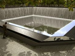 The Memorial design is defined by two reflecting pools, a grove of trees and the names of the victims inscribed in bronze.