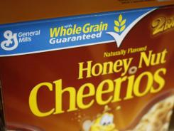 The nation's largest food companies, including General Mills, say they will cut back on marketing unhealthier foods to children, proposing their own set of advertising standards after rejecting similar guidelines proposed by the federal government.