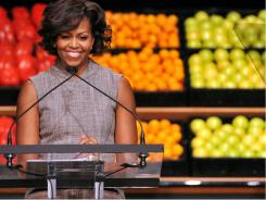 First Lady Michelle Obama speaks as she joins business leaders from Walmart, for an announcement impacting food formulation, availability and affordability in Washington, DC.