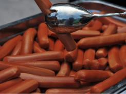 Just one 50-gram serving of processed meat -- about the amount in one hot dog -- a day increases the risk of colorectal cancer, on average, by 21 percent, the study found.