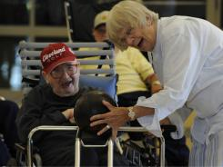 Right up her alley:  Edith Hodge Pletzner gives veteran John Thomas, 92, a hand at bowling at the New  Jersey Veterans Memorial Home at Menlo Park. She visits twice a week to spend time with residents.