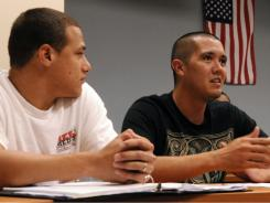 Senior Brian Tullos, 34, right, a former soldier participates in class while USF Junior Cesar Marin, 26, a former soldier looks on.  At the University of South Florda, there's a 3-credit upper-level elective course exclusively for veterans, called Veterans Success. It is designed to help with the transition from combat to the classroom.