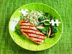 Plate of salmon, rice and spinach.