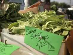 Farmers markets have grown from carrying familiar produce like these snap peas to more exotic items like stevia, horseradish leaves and pig tails.