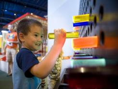 Kai Green, 4, of Cherry Hill, N.J. plays in the bright light section at at the Garden State Discovery Museum in Cherry Hill on Aug. 12. In an age when worried parents are too afraid to let their overscheduled kids roughhouse or play outside freely, experts stress the importance of play.