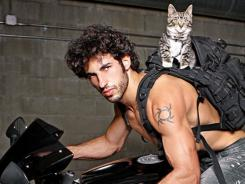 "Benjamen  Baron, a personal trainer,  had no problem showing his softer side by posing with his rescued gray tabby William. ""He's very social and very intelligent,""  Mr. January says about his cat. ""He's always planning something."""