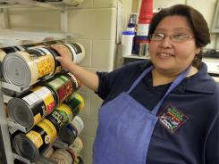 School food service worker Alina Mendoza was excited this summer when a federal grant provided money for her daughter and other children to pick up backpacks full of food each Friday from a local elementary school.