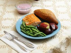Salmon, with green beans, whole grain roll, apple and yogurt.