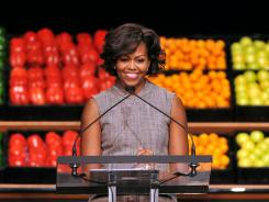 Michelle Obama joined Walmart leaders in January and today joins Darden restaurant executives announcing a healthy-food initiative.