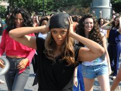 TV personality Tyra Banks tapeing a segment for her show, also traded in her weave and revealed her natural hair for her 5th season in 2009.
