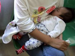Higher amounts of breast-feeding among all milk consumed during children's first 14 months was associated with significantly higher mental scores compared to children who breast-fed less. 