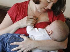 Jessica Ewald breast-feeds her 5-month-old son Bennett. Like many new moms, she got a hospital goody bag with supplies including free formula and formula coupons that she gave away as soon as she got home.