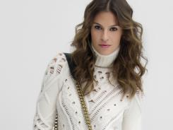 This product image courtesy of Net-A-Porter shows an Altuzarra turtleneck sweater paired with a Rick Owens Lilies maxi skirt and an Etro bag. From grunge to mod to preppy, the basic turtleneck - one of those wardrobe workhorses -can morph into almost any look you want it to be.
