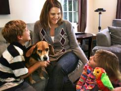 Lisa Osterman, 33, chats with her children Owen, 5, and Ellen, 7, at their Indianapolis home. She was diagnosed with breast cancer two years ago.
